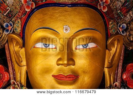 Maitreya Buddha statue face close up in Thiksey Gompa. Ladakh, Jammu and Kashmir, India