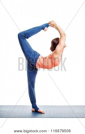 Beautiful sporty fit woman doing yoga asana Natarajasana - Lord of the dance pose advanced variation isolated on white