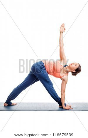 Woman doing Ashtanga Vinyasa yoga asana Parivrtta trikonasana - revolved triangle pose isolated on white