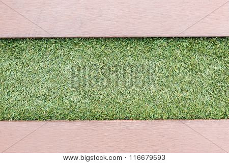 Artificial Grass With Wooden Texture Backgroud