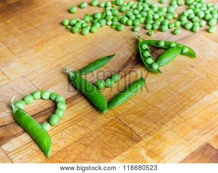 Word PEA written with peas