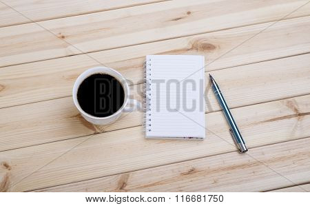 Blank Spiral Note Pad, Cup And Pen On Wood