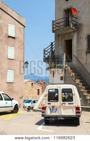 Corsica Island, Small Town Street View With Parked Cars