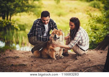 Young Couple Outdoors With Dog