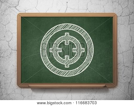 Business concept: Target on chalkboard background