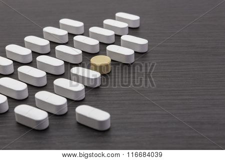 aligned white pills on the table, concept