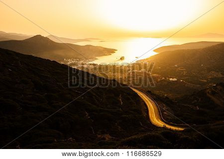 Landscape View Of Dramatic Ocean Coastline And Port At Sunset