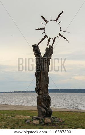 Wooden sculpture on the waterfront of Lake Onega