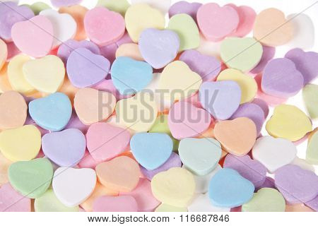 Close up of Candy Hearts on white background