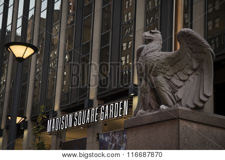 NEW YORK - NOV 25 2015: The 7th Avenue entrance to Madison Square Garden sports arena in Manhattan, with the large stone eagle sculpture in foreground. NY Penn Station is located underneath the arena.