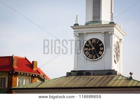 The clock tower and belfry of the old state house and market house building located in the rotary at the center of Fayetteville, North Carolina.