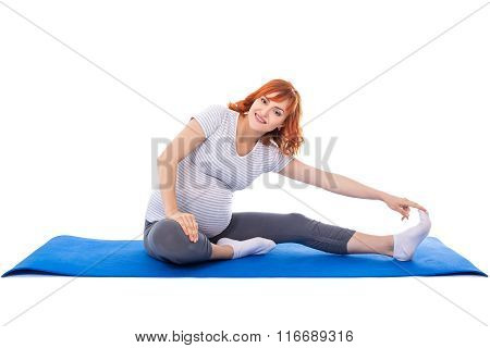 Young Pregnant Woman Doing Stretching Exercises On Yoga Mat Isolated On White