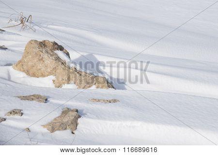 Snowdrift And Rocks