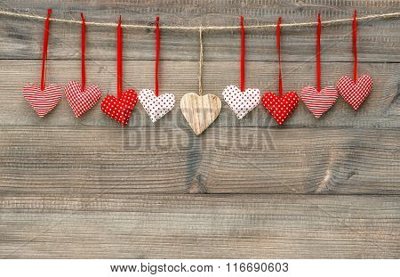 Red Hearts Over Wooden Background. Valentines Day Decoration