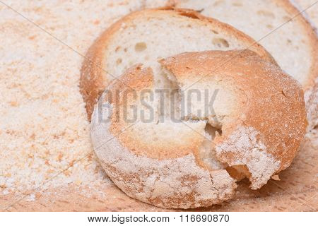 Pieces of bread on the background of bread crumbs