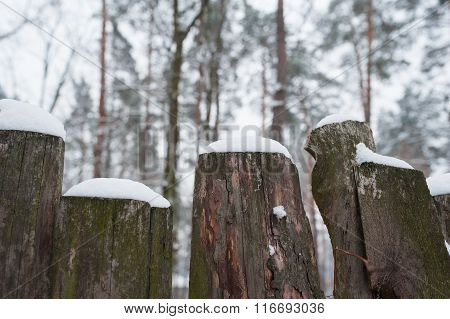 Snow-covered Old Rural Wooden Fence In Winter Time