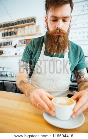 Handsome man preparing coffee in coffee shop