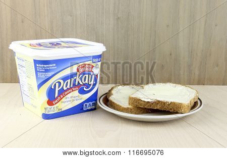 Tub Of Parkay Vegetable Oil Spread And Two Pieces Of Buttered Bread