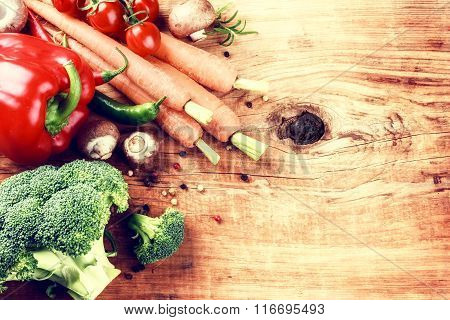 Cooking Setting With Fresh Organic Vegetables On Old Wood Background. Healthy Eating Concept
