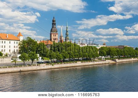 Towers of Riga and castle seen across river Daugava. Three church towers in the picture are the Riga Dome cathedral,  St. Saviour's Church and St. Peter's church.