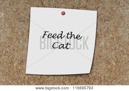 Feed The Cat Written On A Memo