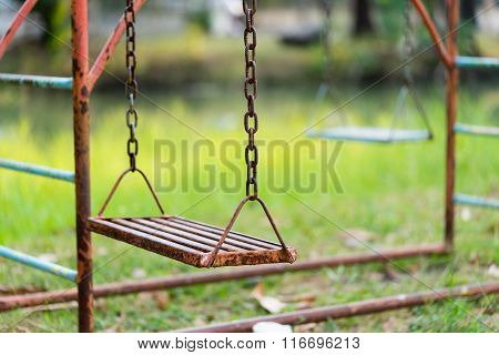 Old Rusty Playground Swing In The Park