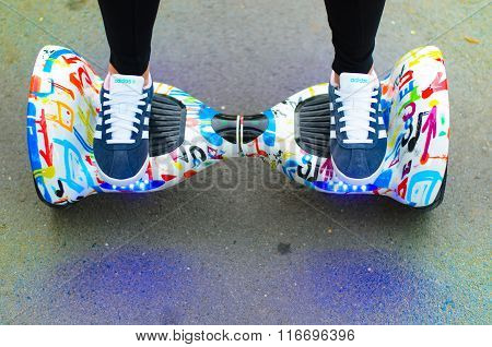 BUCHAREST, ROMANIA, - NOVEMBER 10, 2015: Girl using hoverboard, a self-balancing two-wheeled board.