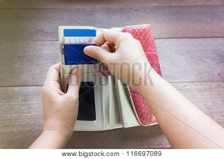 Hands Pull Credit Card Out Of Wallet