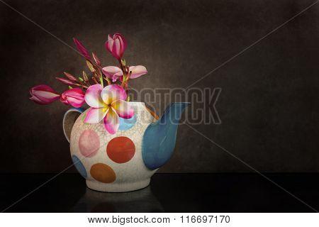 Beautiful Flower Plumeria Or Frangipani In Teapot