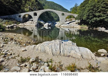 Reflection of Devil's Bridge in Arda river and Rhodopes mountain, Kardzhali Region, Bulgaria