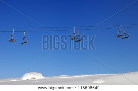 Chair-lift And Blue Clear Sky At Sun Day