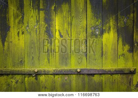 Dark Wooden Wall Background With Green Lichens And Iron Element