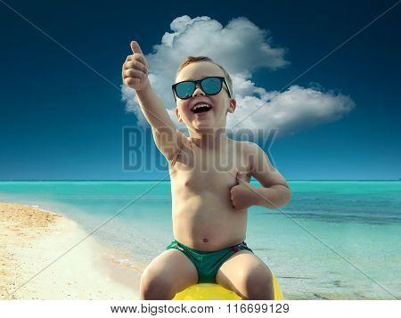 Child in sunglasses fun near the water under sunlight