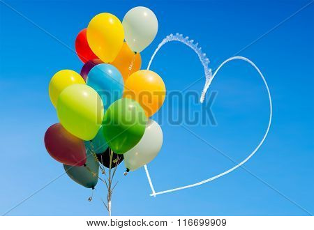 Colorful Balloons And Heart Written In The Sky By Aircraft