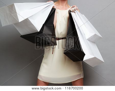 Woman Holding Paper Shopping Bags