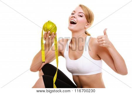 Woman Holding Grapefruit  And Tape With Thumb Up.
