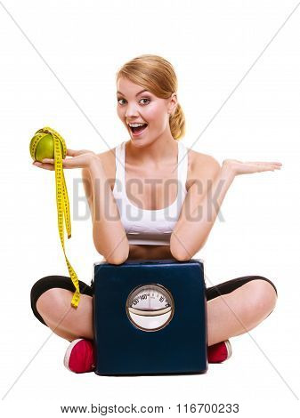 Happy Woman With Grapefruit And Weighing Scale