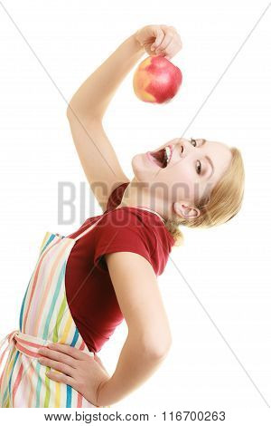 Housewife In Kitchen Apron Eating Apple Healthy Fruit