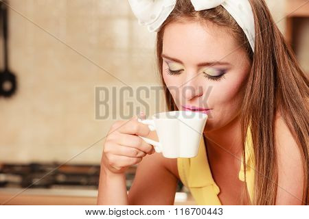 Pretty Pin Up Girl Drinking Tea Or Coffee At Home.