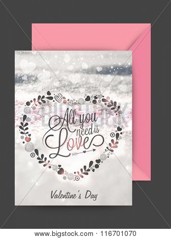 Floral heart decorated greeting card design with pink envelope for Happy Valentine's Day celebration.