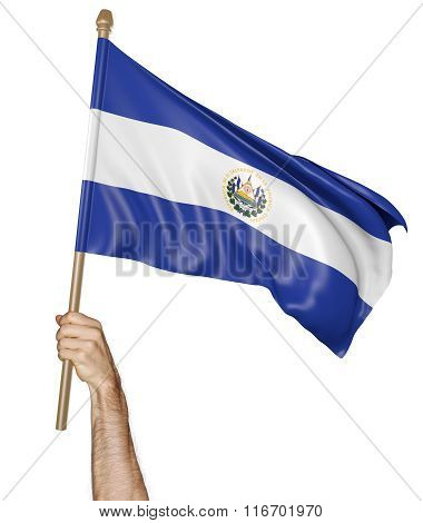 Hand proudly waving the national flag of El Salvador