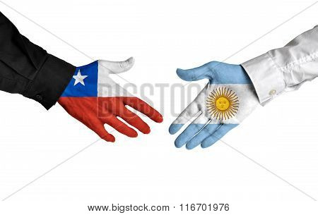 Chile and Argentina leaders shaking hands on a deal agreement