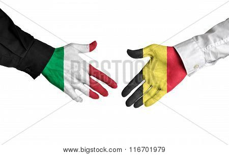 Italy and Belgium leaders shaking hands on a deal agreement