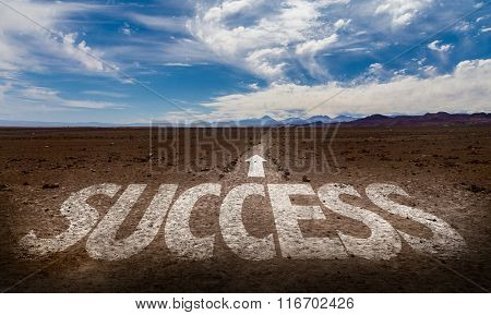 Success written on desert road