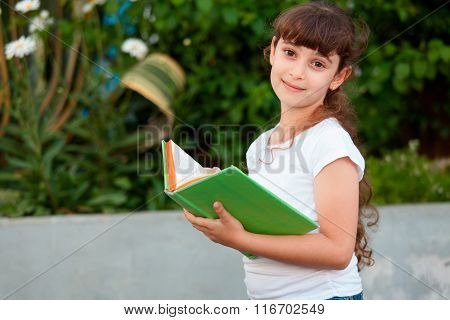 Cute Little School Girl  Reading Book