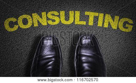 Top View of Business Shoes on the floor with the text: Consulting