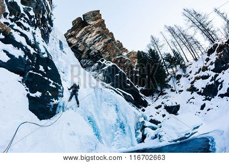 Ice climbing: male climber on a icefall in italian Alps. Cogne (Val d'Aosta) - Italy.