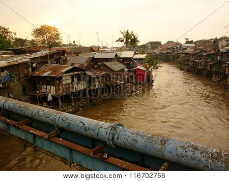 Shanty town on the banks of a polluted river in Jakarta, Java, Indonesia