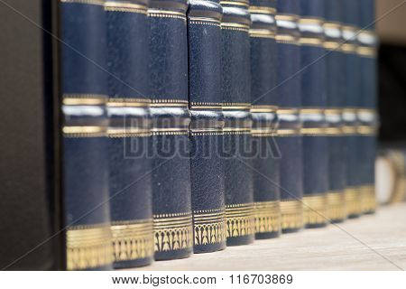 Row of old books on a shelf