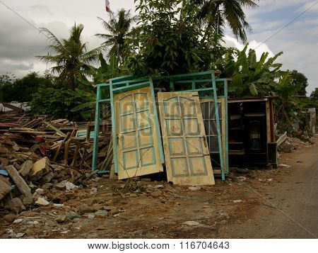 Salvaged doors of a house destroyed by the May 29 2006 Yogyakarta earthquake, Java, Indonesia